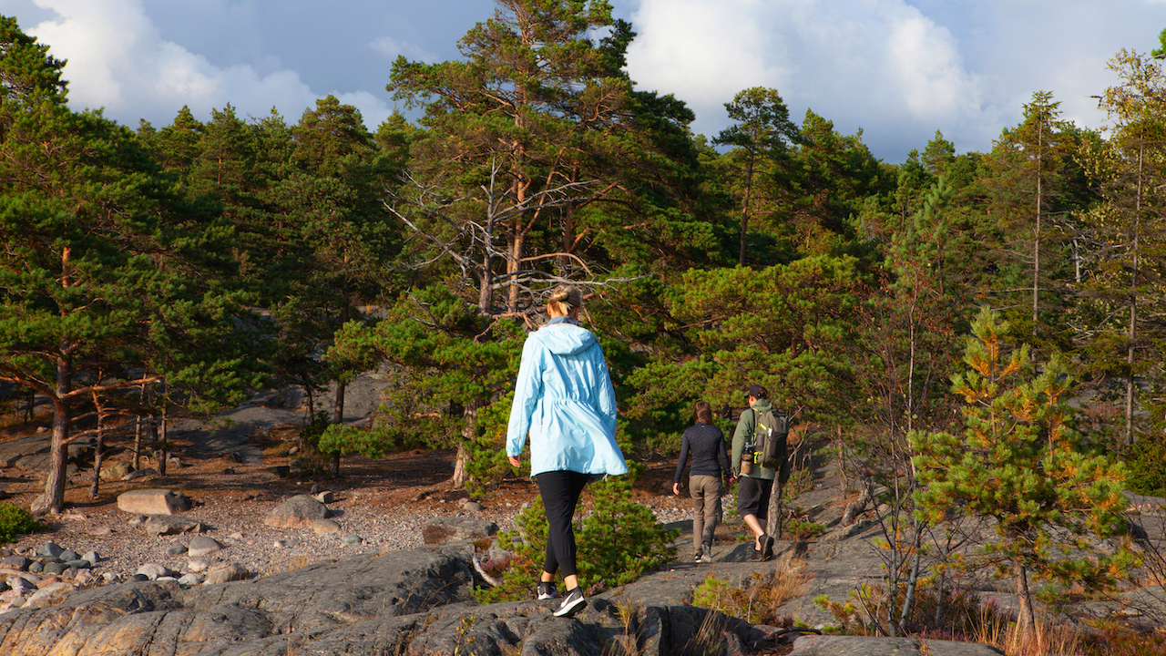 people walking in nature outside of helsinki