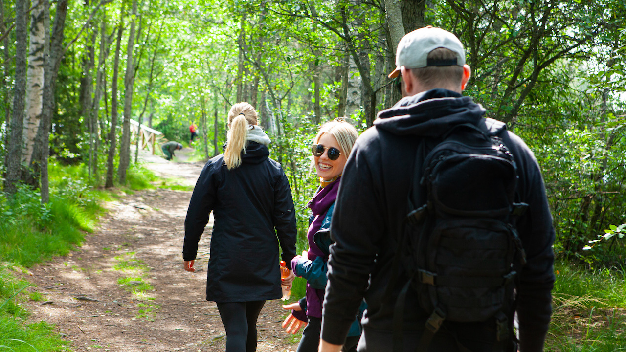 people walking on a nature trail in national park