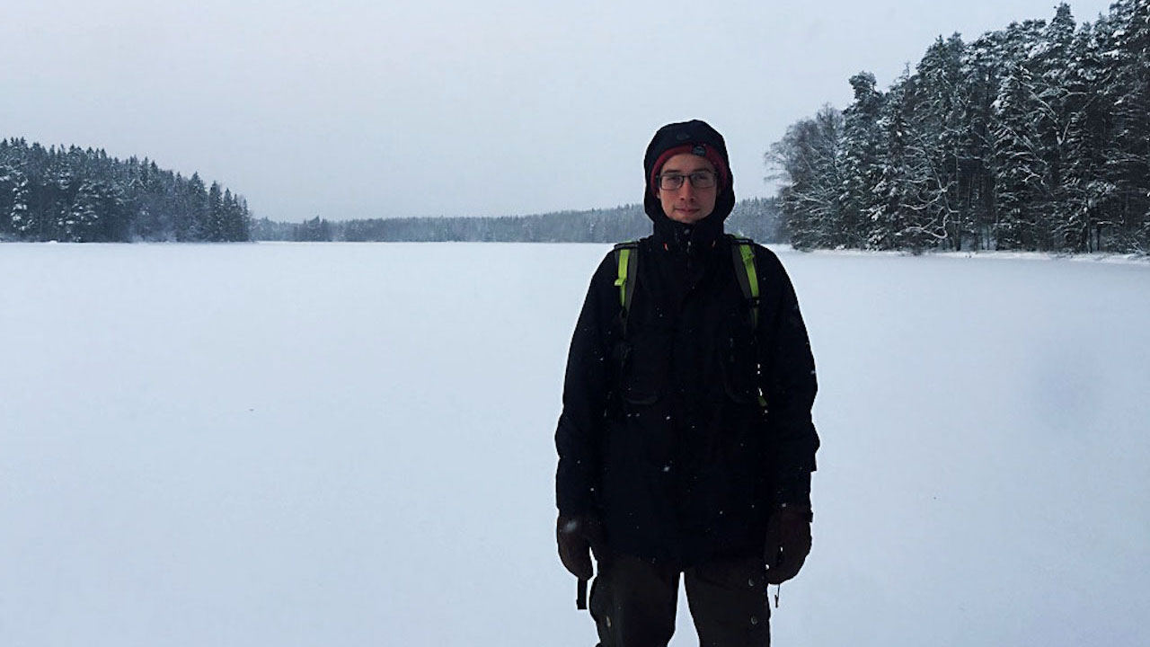 man on snowshoe day trip from helsinki on frozen lake