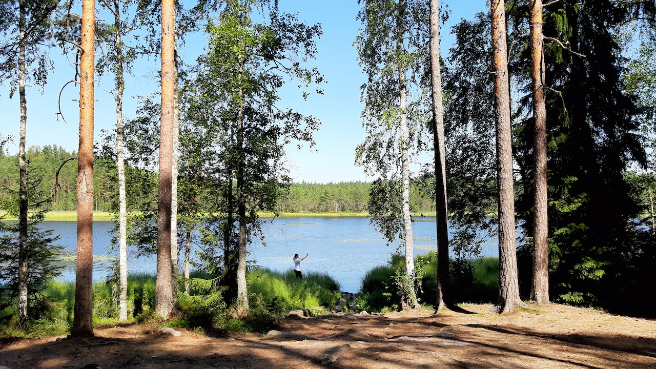 guest taking a selfie by the lake in finnish national park