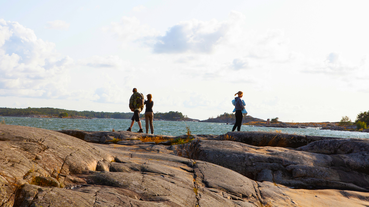 people taking photos in archipelago sea view near helsinki