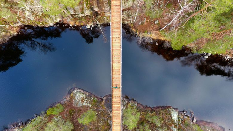 woman walking on a bridge in a finnish national park