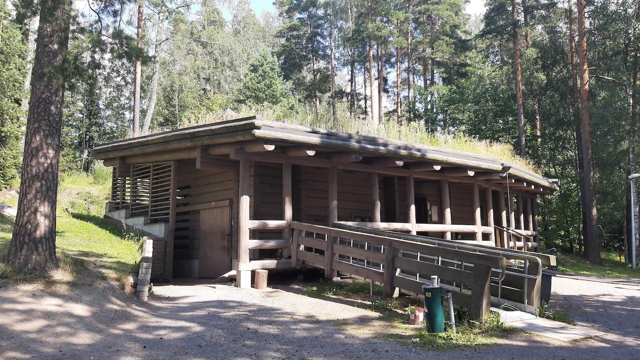 finnish smoke sauna by a lake