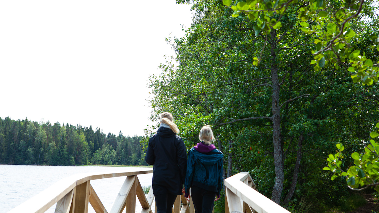 guests walking on a bridge in a finnish national park