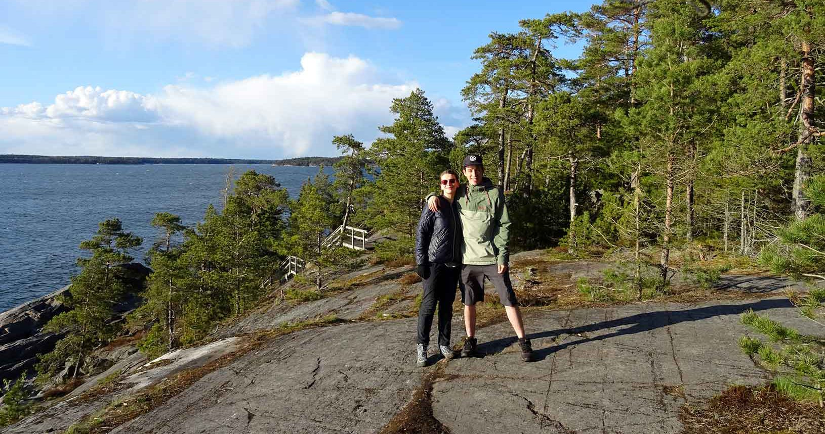 Girl and boy smiling in a archipelago in Finland
