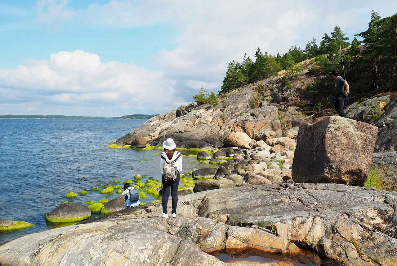 people standing on finnish archipelago