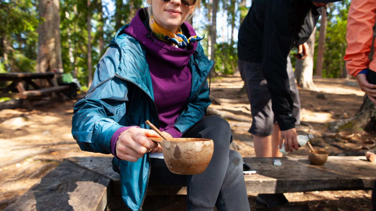 Lunch break in Liesjarvi National Park girl enjoying coffee